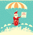 Santa Claus on parachute fly in winter sky vector image
