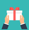 give gift man holds white gift box with a red vector image vector image