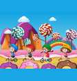 children riding bike on beach full of candy vector image