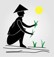 A farmer working in rice fields under the sun vector image
