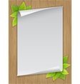 paper sheet and green leaves on wooden background vector image