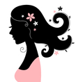 Beautiful woman silhouette with flowers in hair vector image