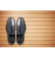 Classic Men Shoes on wooden background vector image