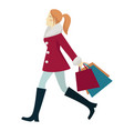 young woman in red coat shopping during winter vector image