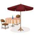 A table with an umbrella in a cafe vector image vector image