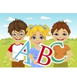 kids holding the abc letters in flower field vector image vector image