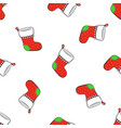 seamless pattern with falling christmas red socks vector image