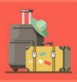 suitcase on wheels with hat and old fashioned vector image vector image