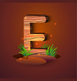 wooden letter e decorated with grass vector image vector image