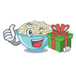with gift rice bowl mascot cartoon vector image