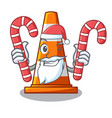 Santa with candy on traffic cone against mascot