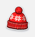 red winter hat with pompon and snowflake pattern vector image vector image