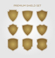 gold shield set geometric premium logo icon vector image