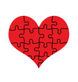 red heart assembled of puzzle pieces isolated vector image