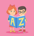 two caucasian kids studying with an abc-book vector image vector image