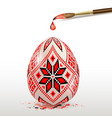 red decorative easter egg and paintbrush vector image vector image