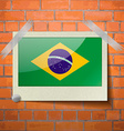 Flags Brazil scotch taped to a red brick wall vector image