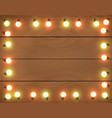 christmas lights on wooden background frame vector image vector image