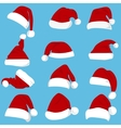 Set of red Santa Claus hats isolated on white vector image vector image