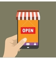 hand holding mobile phone with shop icon on it vector image