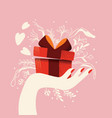 hand holding a gift box with hearts coming out vector image