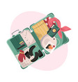 suitcase with packed female clothes for travel in vector image