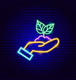 hands holding plant neon sign vector image