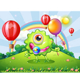A baby green monster at the hilltop with a rainbow vector image vector image