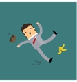 Businessman slipping on a banana vector image