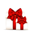 Two gift boxes with red bow isolated on white vector image