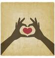 hands in heart shape on vintage background vector image