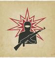 terrorist with gun old background vector image