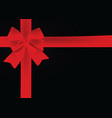 red bow on black background vector image vector image