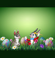 two easter bunnies with easter eggs in a field vector image vector image
