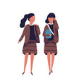 pair of girls dressed in school uniform female vector image vector image