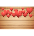 Wooden background with red hearts vector image