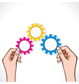 color gear in hand vector image vector image