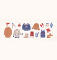 bundle of knitted winter clothes and outerwear vector image