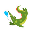 friendly crocodile playing with balloon funny vector image
