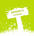 Spring is coming concept with sign post vector image vector image