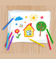 color pencils lying on paper with child drawing vector image vector image