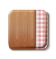 wooden table covered with a checkered tablecloth vector image