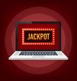 shining retro sign jackpot banner on laptop vector image