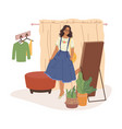 woman in fitting room trying on skirt at mirror vector image vector image