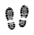 footprints and shoeprints icons in black and white vector image vector image
