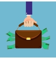 Hand holding briefcase full of money flat style vector image