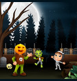 happy kids wearing a halloween costume in the full vector image vector image