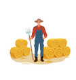 farmer man character work with pitchfork and hay vector image