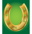 lucky horseshoe on green background vector image