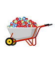 wheelbarrow and gems treasures in garden trolley vector image
